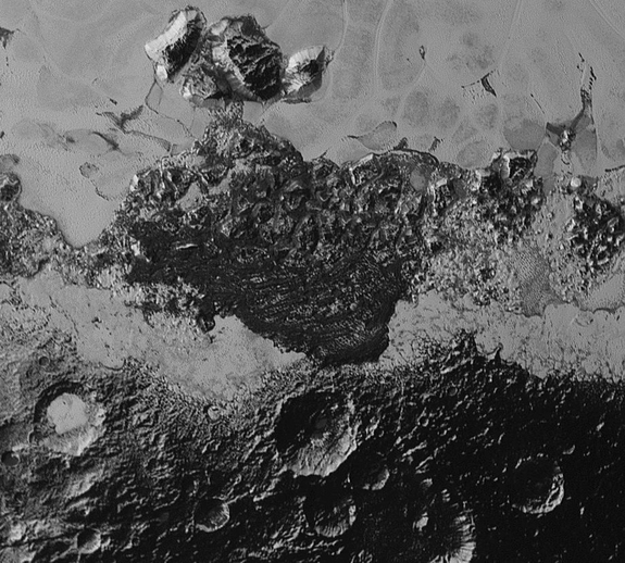 The dark ridges in the center of this view, near the bottom of Sputnik Planum, suggest possible windswept dunes. Also visible is old, cratered terrain juxtaposed with new, smooth ground, as well as mountains.