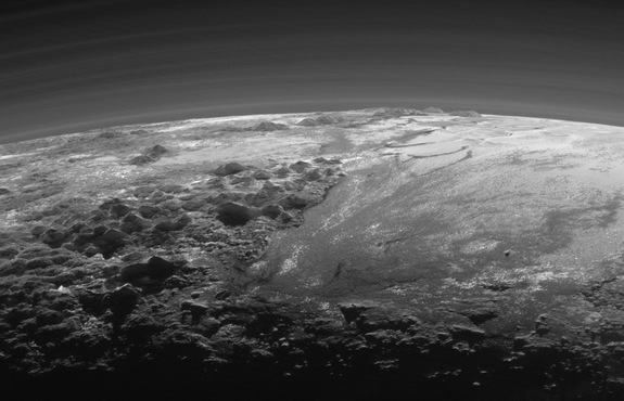 A zoomed-in view of a photo NASA's New Horizons probe took on July 14, 2015, when it was just 11,000 miles (18,000 kilometers) from Pluto. The near-sunset scene, which is 230 miles (380 km) across, shows rugged ice mountains up to 11,000 feet (3,500 meters) high and wide, flat plains.