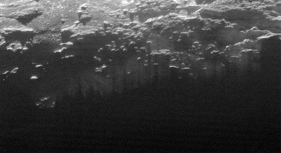 The setting sun illuminates fog or near-surface haze on Pluto in this small section of an image taken by NASA's New Horizons probe on July 14, 2015, when it was 11,000 miles (18,000 kilometers) from the dwarf planet. The image covers a stretch of land 115 miles (185 km) wide.