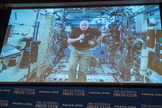 On Sept. 14, 2015, astronaut Scott Kelly participated via video link from the International Space Station in a discussion with astronaut Terry Virts and Kelly's twin brother, retired astronaut Mark Kelly, at the National Press Club in Washington.