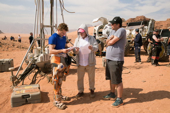 Ridley Runs Lines With Matt:  Director and lead actor confer on location in the Jordanian desert.
