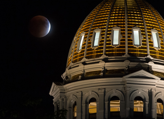 Bill Ingalls prisoner this shot of a 'supermoon' lunar obscure Sept. 27 over a Colorado State Capitol Building in Denver.