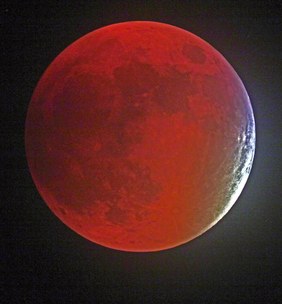 "Despite lots of clouds and rain on the way, Victor Rogus grabbed this picture of the Sept. 27 'supermoon' lunar eclipse in Manatee County, Florida. -- ""Before clouds doomed my efforts,"" he told Space.com."
