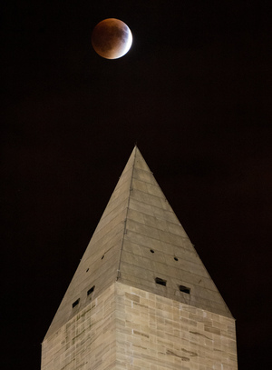 NASA photographer Aubrey Gemignani captured this stunning view of the perigee moon lunar eclipse over the Washington Monument in Washington, D.C. on Sept. 27, 2015.