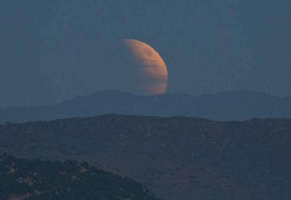 Skywatcher John Melson of Escondido, California captured this jaw-dropping view of the eclipsed moon rising over nearby hills during the total lunar eclipse of Sept. 27, 2015. He compared the moon to the Death Star from Star Wars.