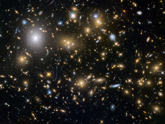 This image from the NASA/ESA Hubble Space Telescope shows the galaxy cluster MACSJ0717.5+3745. This is one of six being studied by the Hubble Frontier Fields programme, which together have produced the deepest images of gravitational lensing ever made. Image released Oct. 22, 2015.