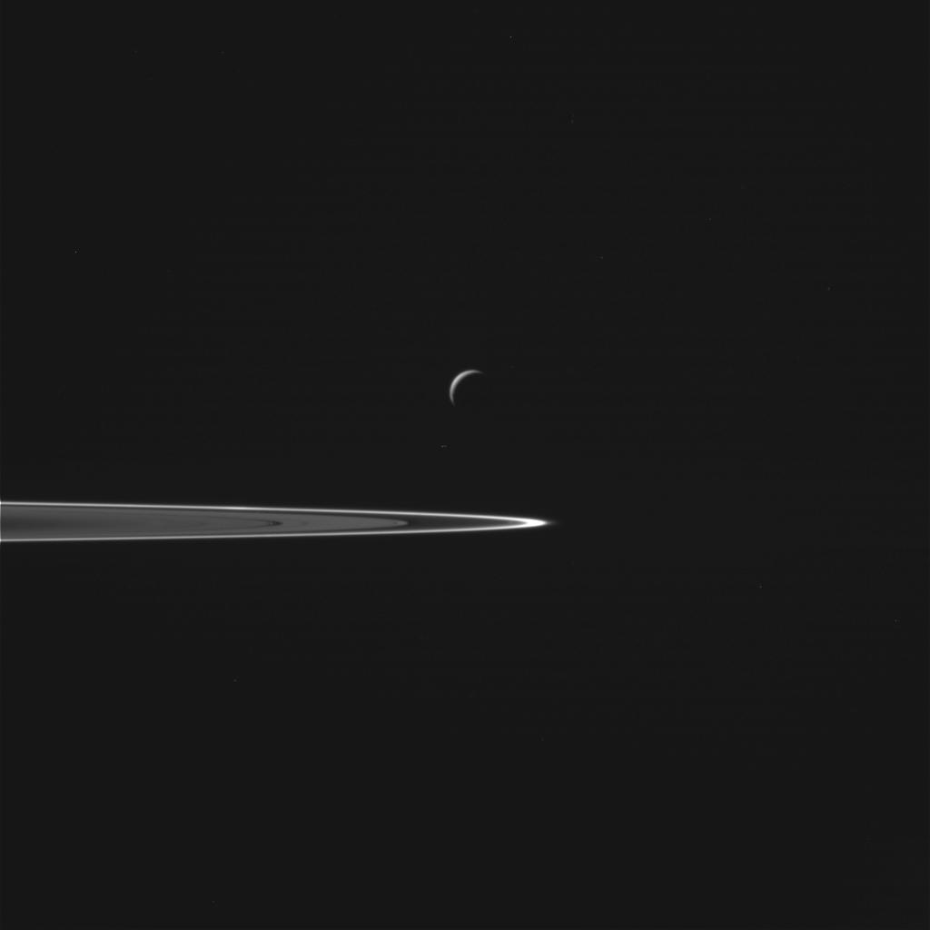 Saturn's Moon Enceladus and Saturn's Rings