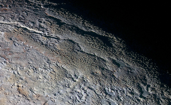 Snakeskin ridges on Pluto may have been shaped by surface winds, one way Pluto's atmosphere could have contributed to the dwarf planet's unusual features.