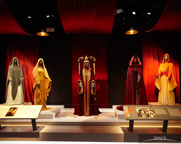 "Many of the dresses worn by Queen Amidala in the ""Star Wars"" prequels are on display in Times Square, as part of a new costume exhibit."