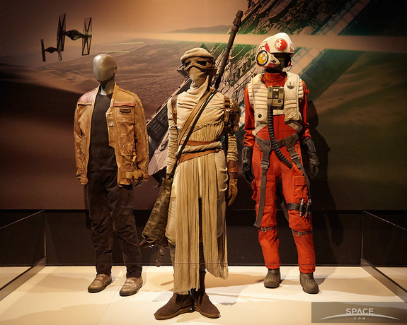 """Costumes from the upcoming movie """"Star Wars: The Force Awakens"""": (l to r) Finn, Rey, Poe Dameron."""
