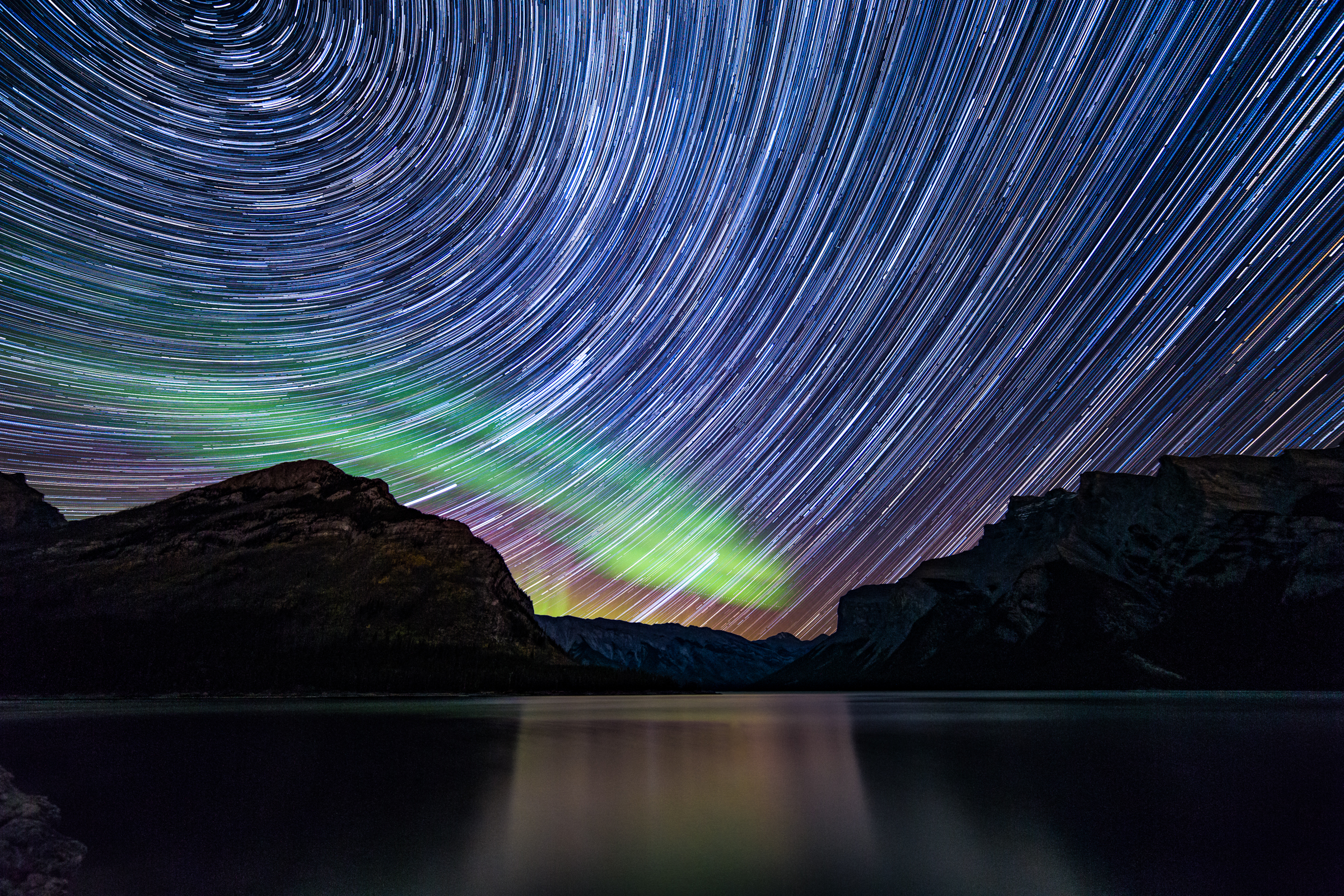 Star Trails and a Green Auroras Shine in Astrophotographer Photo
