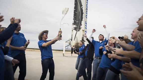 Blue Origin billionaire founder Jeff Bezos (Amazon.com's CEO) and team members celebrate after the successful first spaceflight and landing of its New Shepard spacecraft and booster. The test flight launched from West Texas on Nov. 23, 2015.