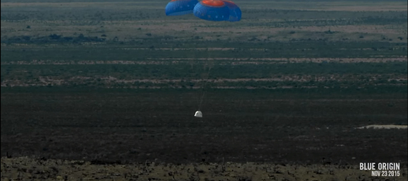 Blue Origin's New Shepard space capsule floats back to Earth under parachutes after a successful unmanned suborbital test flight from the company's West Texas facility on Nov. 23, 2015.