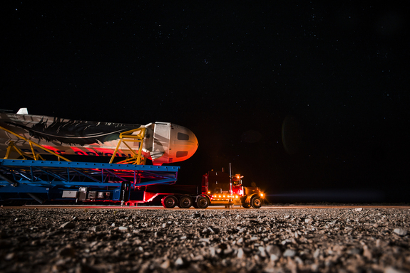 Blue Origin engineers roll the company's New Shepard spacecraft and rocket to the launch pad at the firm's West Texas proving grounds for an unmanned suborbital test flight on Nov. 23, 2015.