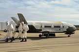 Recovery crew members process the X-37B Orbital Test Vehicle at Vandenberg Air Force Base after the program's third mission complete.