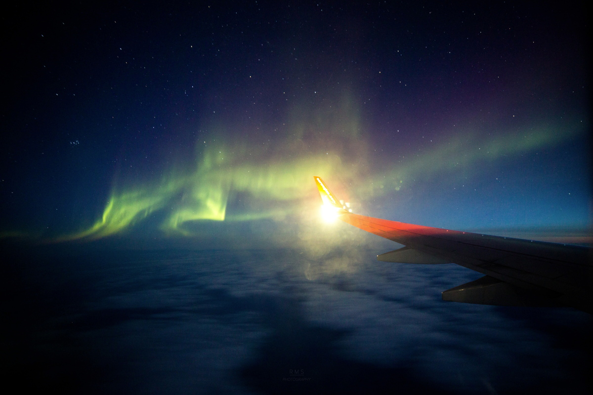 Aurora Seen from Plane Over Barents Sea