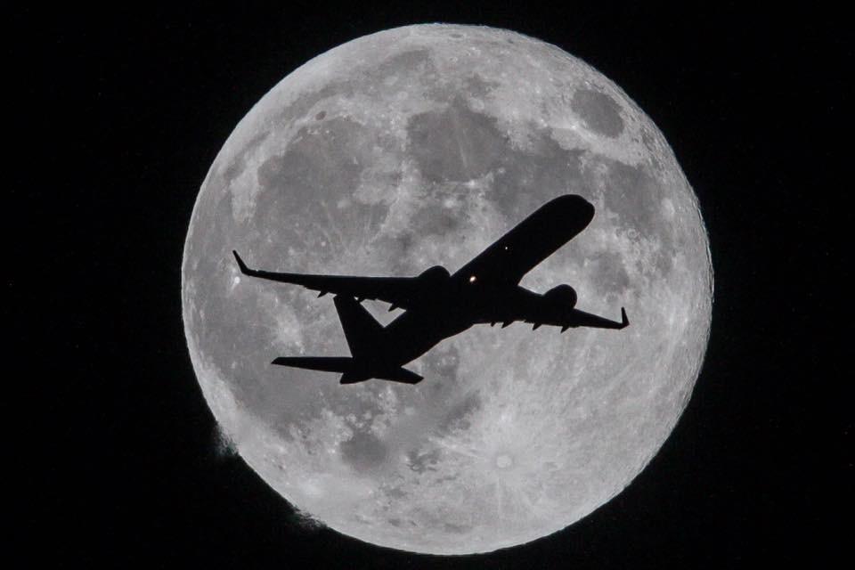 Plane Crossing the Moon by Raul Roa