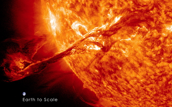 Image of the Earth to scale with the filament eruption. Note: the Earth is not this close to the sun, this image is for scale purposes only.