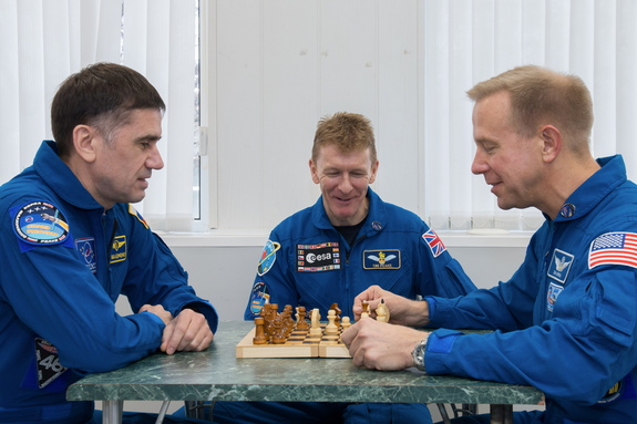 The three Expedition 46-47 crewmembers — Yuri Malenchenko, Tim Peake and Tim Kopra (left to right) — play chess during training. Only three men alive know who won this match… and they're not telling, because they've got more important things to do. They're in space.