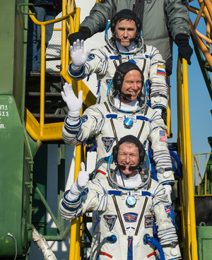 Russian cosmonaut Yuri Malenchenko (top), NASA astronaut Tim Kopra (center) and British astronaut Tim Peake of the European Space Agency wave farewell as they board their Soyuz rocket for a launch to the International Space Station on Dec. 15, 2015 at Baikonur Cosmodrome in Kazakhstan. The trio launched on a six-month mission to the station.