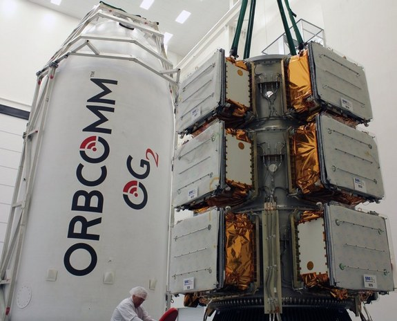 Eleven Orbcomm spacecraft are attached to their dispenser prior to being encapsulated within the Falcon 9's payload fairing.