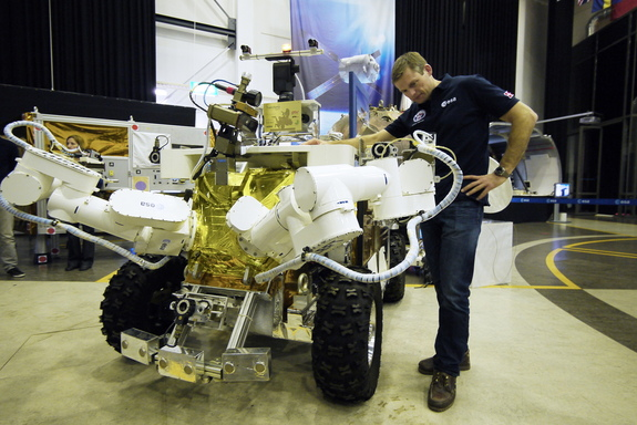 ESA astronaut Andreas Mogensen and the Eurobot, which is designed so that astronauts in a spaceship can control it while it's on the surface of a planet or moon. It's one of many robots already working in space.