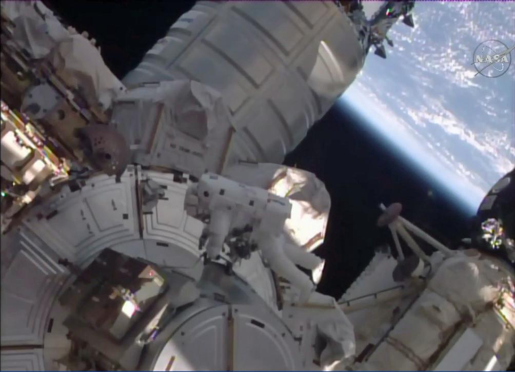 Spacewalking Astronauts Rescue Stuck Space Station Railcar