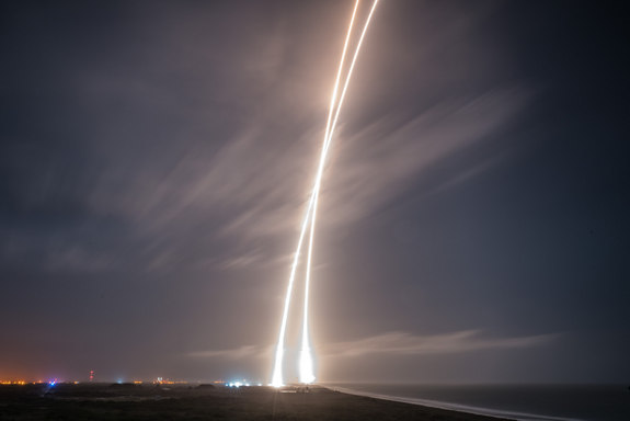 This long exposure captures the launch into orbit of SpaceX's Falcon 9 rocket, and the booster's first stage return to a smooth landing at Cape Canaveral Air Force Station on Dec. 21, 2015.