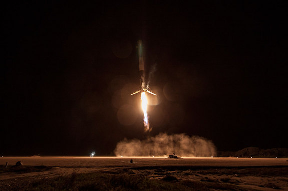A SpaceX Falcon 9 rocket first stage approaches a touchdown at Landing Zone 1 at the Cape Canaveral Air Force Station.