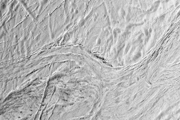 On Saturn's ice-covered moon Enceladus, nearly parallel ridges and furrows mark a region known as Samarkand Sulci in this image as seen by NASA's Cassini spacecraft during its final close flyby of the moon on Dec. 19, 2015.