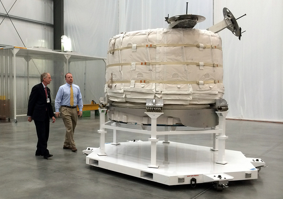 NASA officials view the Bigelow Expandable Activity Module at Bigelow's facility in Las Vegas in March. The module is scheduled for launch to the ISS in early 2016.