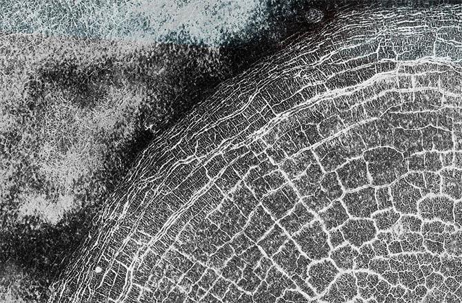 Mars Orbiter Catches a Crater Full of Cracks