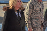 Secretary of the Air Force Deborah James arrives for the Schriever Wargame debriefing on Dec. 17, 2015. She is with Major Gen. David Thompson, Vice Commander of the Air Force Space Command.