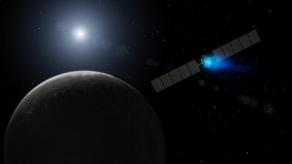 Artist's conception of the Dawn spacecraft arriving at Ceres. The engine's xenon ions glow with blue light.