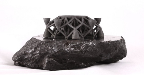 Another look at the geometric object 3D-printed by asteroid-mining company Planetary Resources and its partner 3D Systems using powdered asteroid metal.