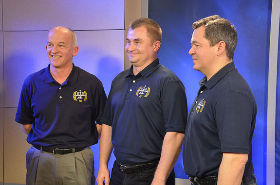 NASA astronaut Jeff Williams with his Soyuz TMA-20M crewmates Alexey Ovchinin and Oleg Skripochka at NASA's Johnson Space Center in Houston on Thursday, Jan. 7, 2016.
