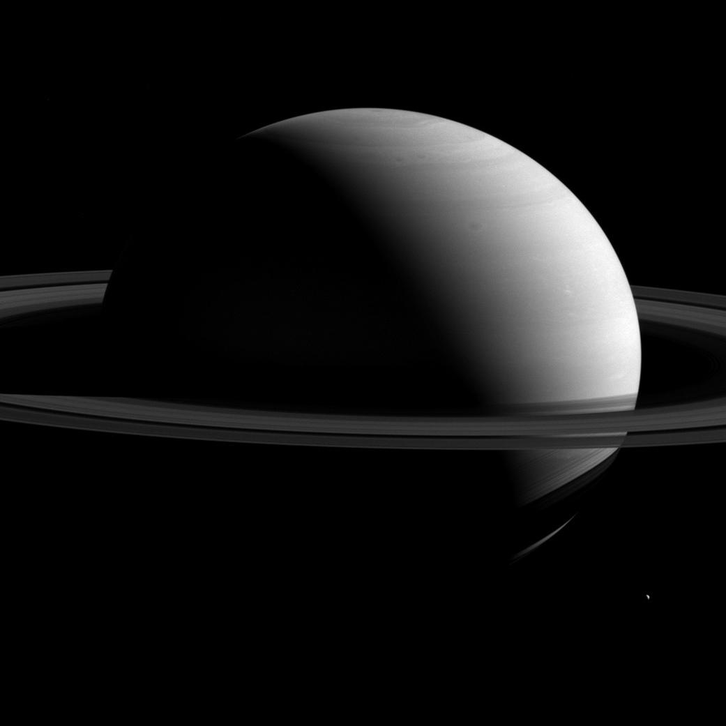 Giant Saturn Dwarfs Tiny Moon Tethys in Jaw-dropping NASA Photo
