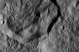 This image, which was taken by NASA's Dawn probe on Dec. 19 from a distance of 240 miles (385 kilometers), shows the 25-mile-wide (40 km) Messor Crater.