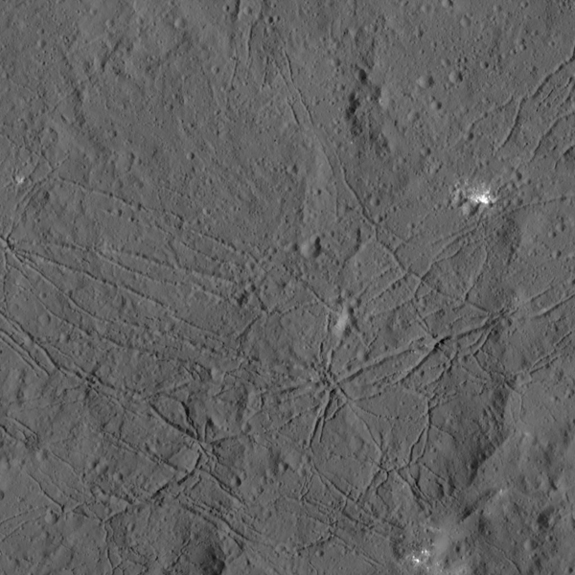 The floor of Ceres' Dantu Crater is highlighted in this image, captured by NASA's Dawn probe on Dec. 19. 2015 from a distance of 240 miles (385 kilometers).