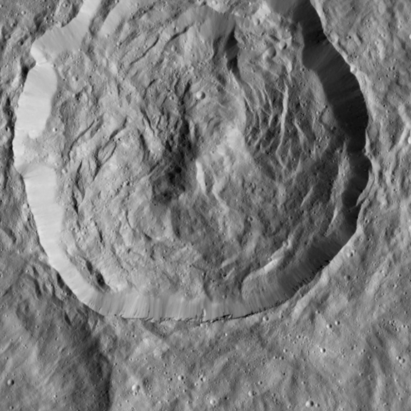 Steep slopes known as scarps are visible within this 20-mile-wide (32 kilometers) crater on Ceres in this image captured by NASA's Dawn spacecraft on Dec. 19, 2015.