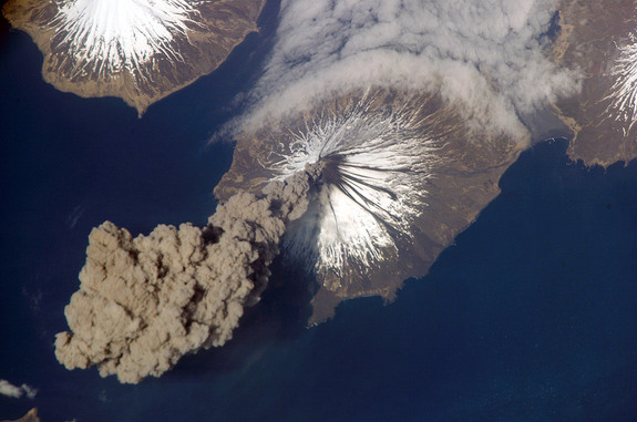 "The erupting Cleveland Volcano in Alaska's Aleutian Islands, captured by International Space Station astronauts in 2006. Earth has a ""secondary atmosphere"" produced in part by volcanoes."