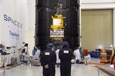 In the SpaceX Payload Processing Facility at Vandenberg Air Force Base in California, scientists and engineers encapsulate the Jason-3 satellite in its payload fairing ahead of its planned Jan. 17, 2016 launch.