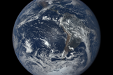 "Earth is undergoing ""unintelligent modification"" of its atmosphere. What would a habitable world look like under the care of an intelligent technological species? (Image of Earth taken by the Deep Space Climate Observatory, or DSCOVR, satellite.)"