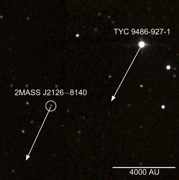 False color infrared image of the star TYC 9486-927-1 and the planet 2MASS J2126; arrows show their projected movement over 1,000 years. The scale indicates a distance of 4,000 astronomical units (AU), where 1 AU is the average distance between the Earth and the sun (about 93 million miles, or 150 million kilometers).