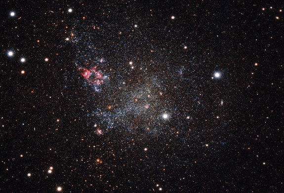 Dwarf galaxy IC 1613, as seen by the Very Large Telescope's (VLT) OmegaCam camera, showcasing its lack of cosmic dust. The VLT is part of the European Southern Observatory, located in Chile.