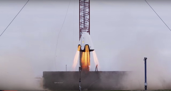 SpaceX's Dragon 2 crew capsule prototype hovers during a rocket motor test in November 2015 in this still from a SpaceX video released in January 2016.