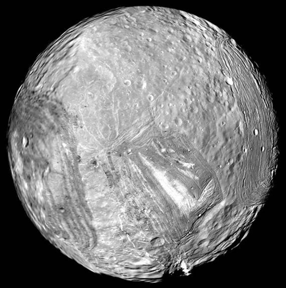 Uranus' icy moon Miranda wowed scientists during Voyager 2's 1986 encounter with its dramatically fractured landscapes.