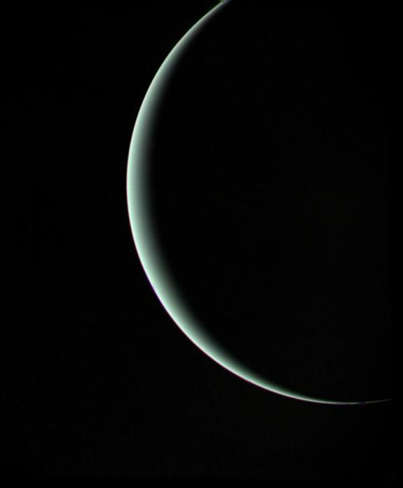 Voyager 2 captured this moody parting shot of Uranus on Jan. 24, 1986, as the spacecraft sped off toward its next adventure at Neptune.