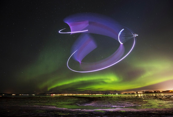 In this stunning long-exposure view, paraglider Horacio Llorens creates light streaks with green auroras in the background during a flight in Tromsø, Norway, on Jan. 13, 2016.