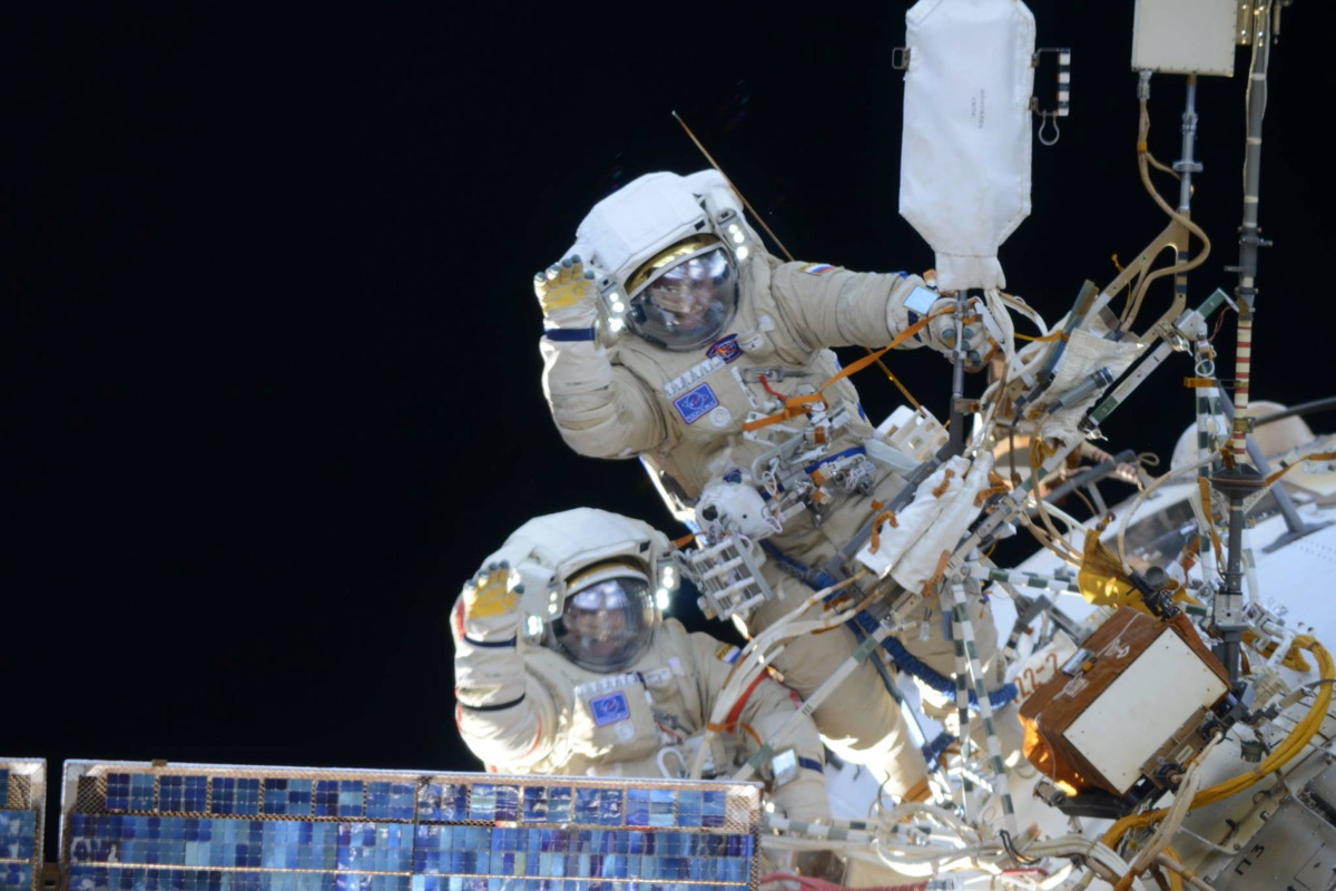 Cosmonauts Wave During Spacewalk